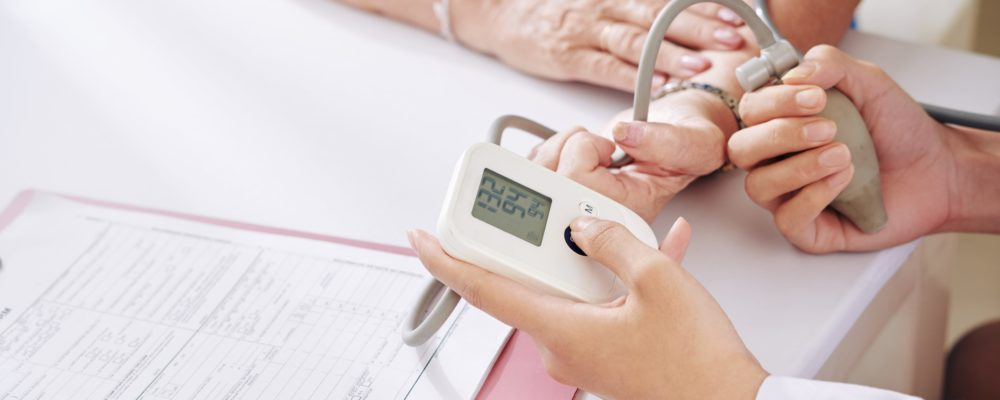 checking-blood-pressure-of-senior-patient-XHM84S8