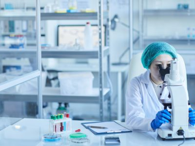 woman-working-alone-in-laboratory-QXLNFUS